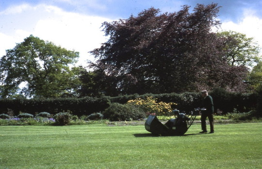 Percy Chaloner mowing the croquet lawn August 1976